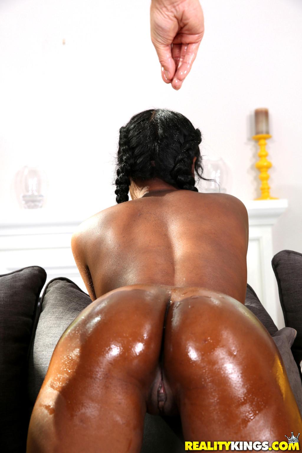 Oily ebony booty gets fucked and creampied