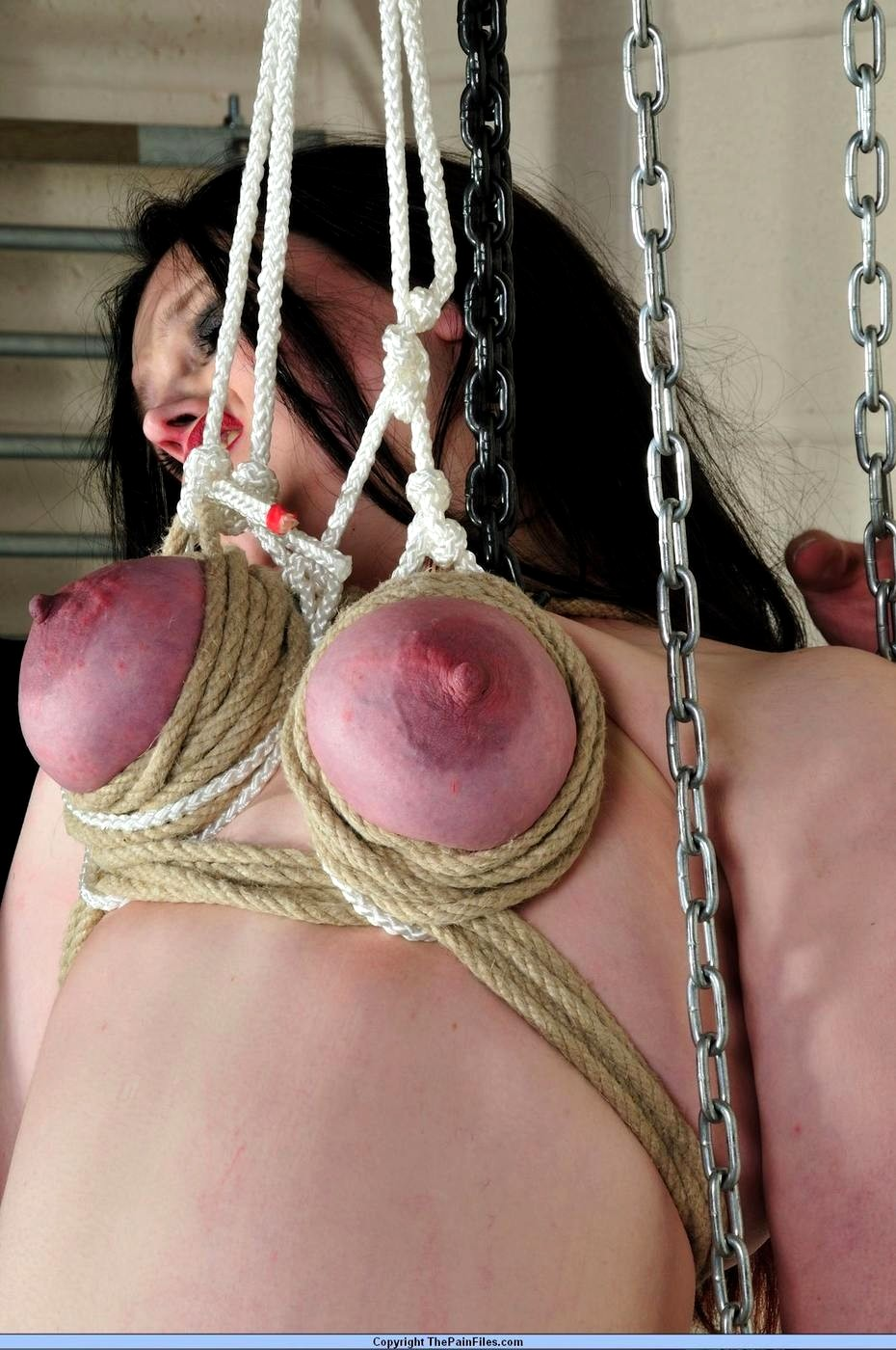 Breast punishment bondage